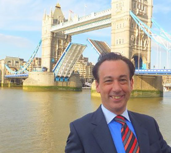 Image of Professor David Goldsmith with Tower Bridge on the Thames in the Background