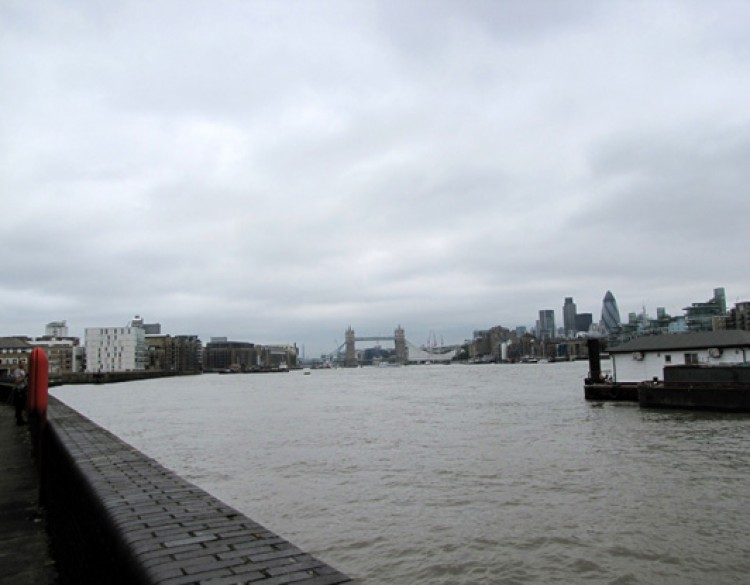 View of Tower Bridge from the Thames on a grey morning.